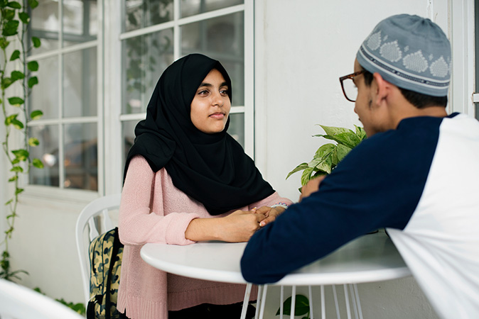 Young Muslim couple in the cafe