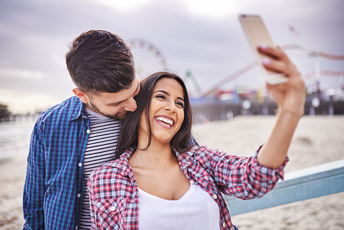 Couple smiling and looking at the phone
