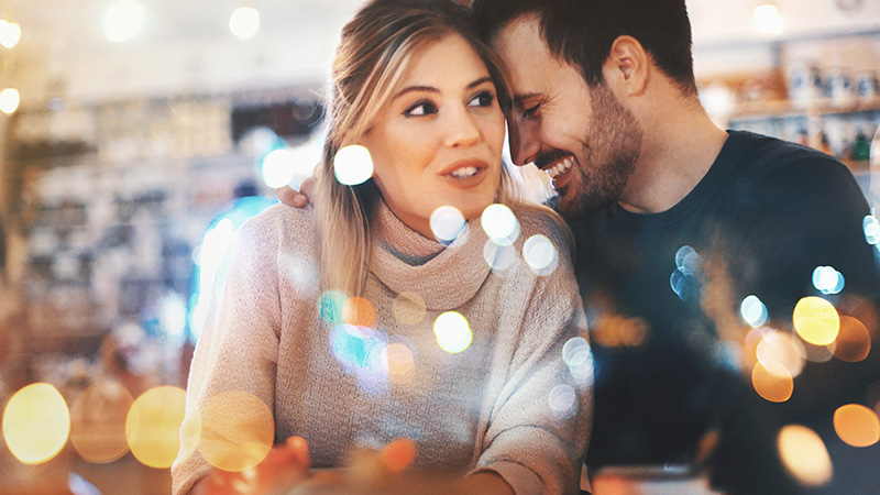 Couple in a cafe laughing