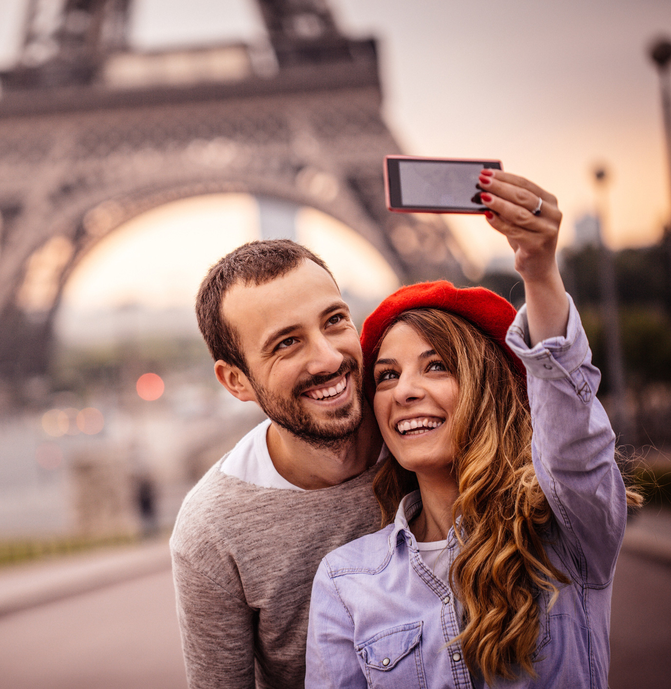 French couple taking pictures for social media