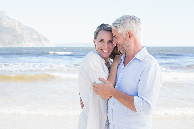 Happy couple over 40 by the sea